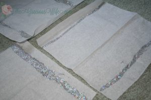 Sparkly tissue paper poms poms fit for a princess. Perfect for birthday parties or nursery decor. Plus a money-saving tip. From TheGraciousWIfe