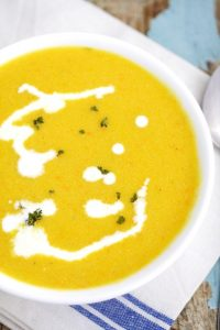 Butternut Squash Bisque Recipe - A creamy, spicy and sweet soup.  Full of vegetables and flavor! The sweet apples in this butternut squash soup combined with the spicy peppers really make it.