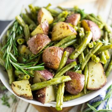 Buttery, crispy red potatoes and fresh green beans tossed with garlic and herbs make these Garlic Herb Roasted Potatoes and Green Beans a simple, elegant, and flavorful side dish for any meal.