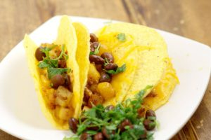 Chorizo Potato Tacos are a quick and easy dinner recipe idea that only takes 30 minutes to make! Crispy potatoes and salty, spicy chorizo are topped with a crisp black bean and cilantro salsa to make a delicious but frugal dinner.