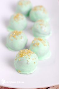Mint Oreo Truffles Recipe - an easy mint chocolate dessert recipe idea, just like your classic Oreo truffles, with added minty flavor for a festive twist. With just 4 ingredients, these smooth, minty, and rich Mint Oreo Truffles could not be easier to make! They'll be the star of the show at your next holiday.So pretty but so easy!