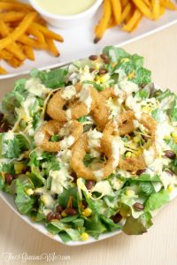 Southwest Salad Recipe with Spicy Honey Mustard Dressing Recipe - an easy salad recipe that's perfect for lunch or dinner. Onion Rings on a salad?! Yes, please!