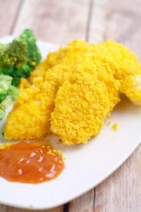 Cheesy Cheez It Chicken Tenders - an easy dinner recipe idea that the kids will love and you will too.  Chicken covered in cheese and Cheez-its and baked until crispy. Mmmm.... Cheese!