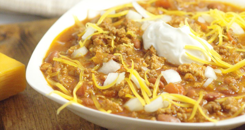Crockpot Beef Chili made with a classic ground beef chili recipe, simmered to comfort food perfection in the slow cooker. Top with your favorites like cheese, onions, or crackers. Delicious, amazing chili, the easy way. Mmm... This looks so good!