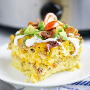 Overnight Crockpot Breakfast Casserole is a classic breakfast casserole with eggs, sausage, bacon, hash browns, and cheese. It's easy to make, great for the holidays and feeding a crowd.