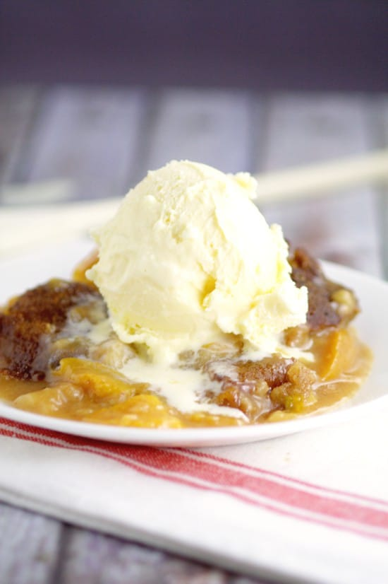Crockpot Peach Cobbler recipe with warm spiced peaches and a simple, sweet cobbler, topped with a crunch cinnamon-sugar topping in the slow cooker for a super fabulous and easy crockpot dessert recipe. Top with ice cream for an amazing dessert.  Peach cobbler is one of my favorites!
