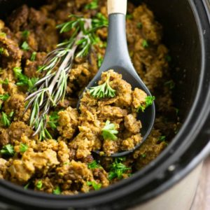 Free up your oven with this simple and classic Crockpot Stuffing! A traditional recipe with onions, celery, and herbs, cooked to perfection in the slow cooker!