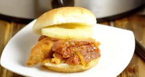Hawaiian Crockpot Ham Sandwiches recipe with slow cooked salty ham along with sweet pineapple and brown sugar, and tangy Dijon mustard, all on one delicious bun. Great crockpot recipe for family dinner.  This would be a great way to use up leftover ham too!