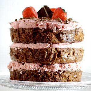 Decadent Dark Chocolate Cake recipe with Strawberry Buttercream is an indulgent chocolate treat.  Sweet strawberry buttercream, sandwiched between layers or rich dark chocolate cake.   Mmmmm... Chocolate and strawberries would be a yummy treat for Valentine's Day too!