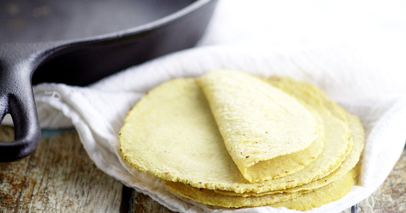 Soft, fresh Homemade Corn Tortillas are easy to make with just 2 ingredients and makes taco night even more delicious. A recipe that all home cooks should know!