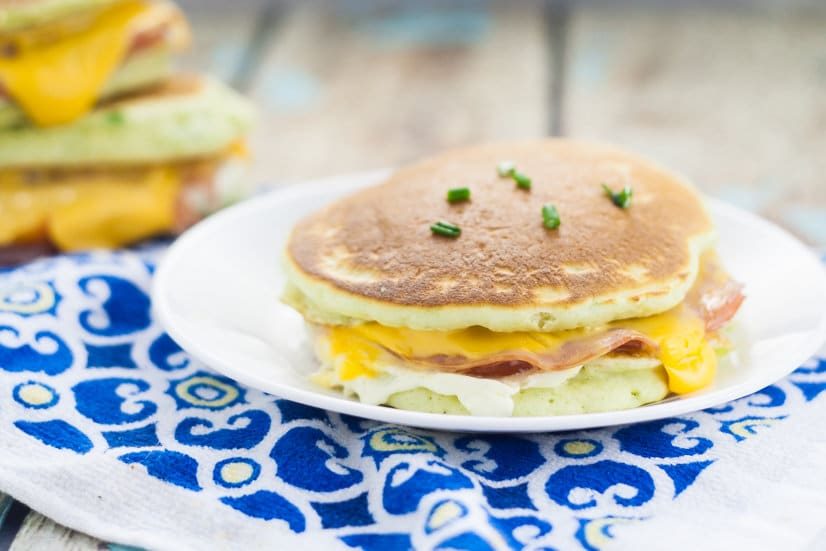 Chive Ham and Cheese Pancake Sandwiches for an easy breakfast recipe.  Unique and tasty Chive Ham and Cheese Pancake Sandwiches that are totally delicious, freezer friendly, and even great for a breakfast on-the-go!
