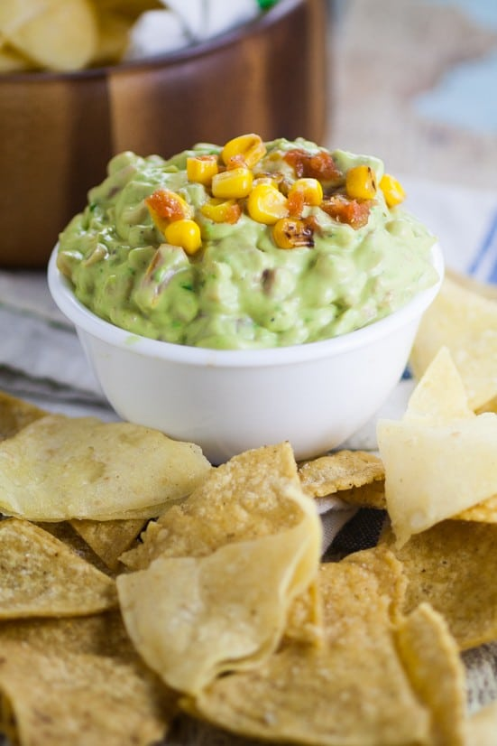 Creamy Corn Guacamole is the the perfect easy appetizer dip recipe for your next party. Chunky and delicious Creamy Corn Guacamole with charred corn, tomatoes, onions, and creamy avocados. Plus a special, easy ingredient to bring this amazing dip to the next creamy level. Must try!