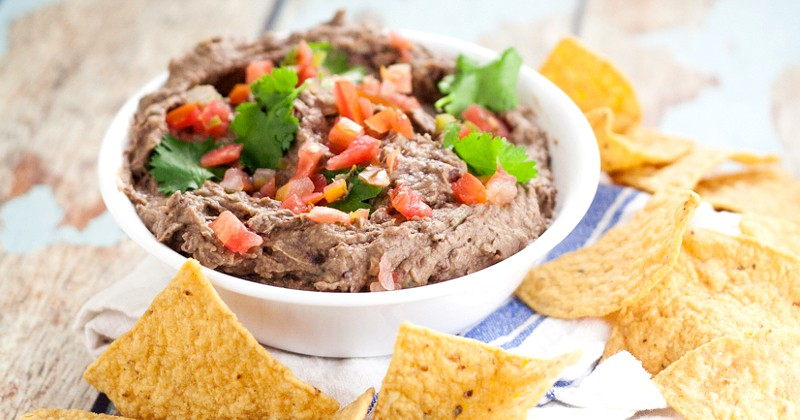 Creamy Black Bean Avocado Dip Recipe -Make this easy and addictive Creamy Black Bean Avocado Dip in just minutes! Makes a healthy snack or heavenly party dip! This is seriously so goodd and ridiculously easy to make. It goes fast every time we make it and is great game day food and for a crowd. Can't believe it takes just 8 minutes to make!