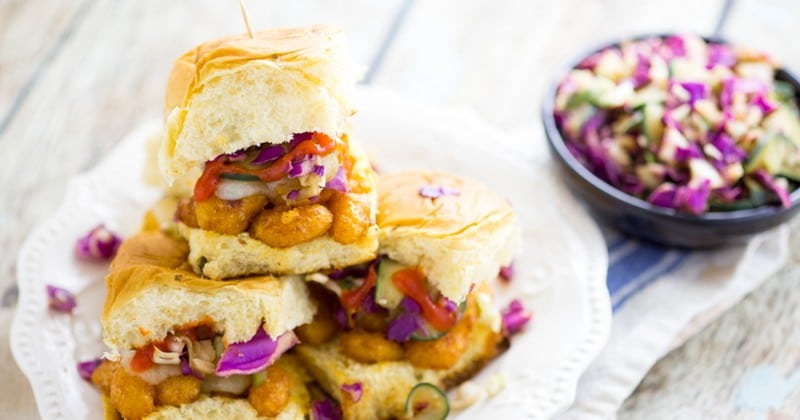 Sriracha Ranch Popcorn Shrimp Sliders recipe - a quick and easy dinner recipe and aclassic-gone-coastal, these zesty Sriracha Ranch Popcorn Shrimp Sliders topped with cheese and a cool, crisp fresh slaw are a perfect quick and easy Summer dinner recipe.