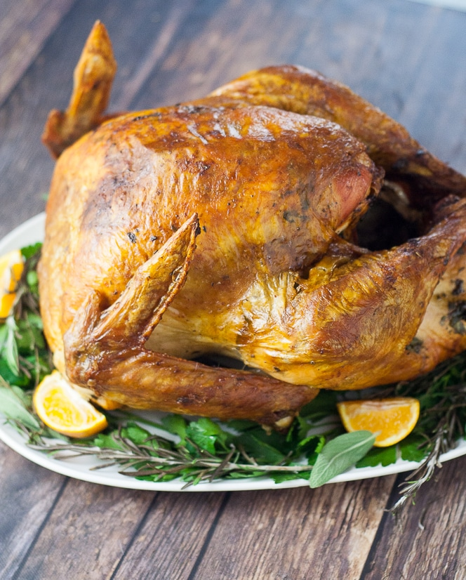 Butter Herb Roasted Turkey recipe that's perfect for a classic Thanksgiving turkey recipe - Golden, juicy, and delicious, this Butter Herb Roasted Turkey recipe won't disappoint with a hint of buttery herb flavor and a beautiful color. Will be the highlight of your holiday table!