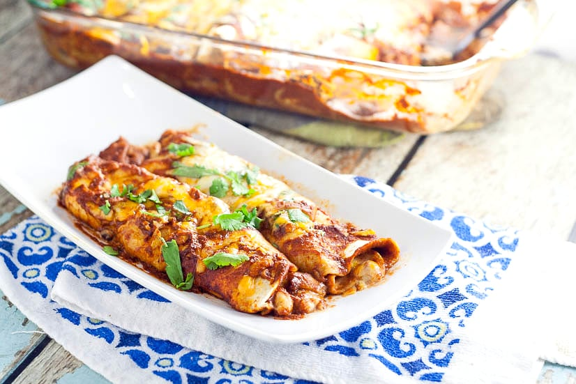 3 Bean Enchiladas Recipe - Quick, easy, and frugal, this 3 Bean Enchiladas recipe with 3 types of beans and lots of cheese is the perfect way to eat vegetarian for a delicious and cheap family dinner recipe!