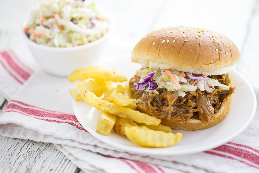 Easy Crock Pot Barbecue Pulled Pork Recipe - Super easy, 3 ingredient Crock Pot Barbecue Pulled Pork is the perfect hands-off dinner for a busy day that everyone will love! Just grab buns at dinner time and you're ready to go!