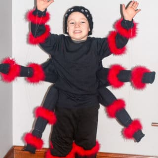 DIY Spider Costume for Kids - Make this easy, fun, and creepy DIY Spider Costume for Kids for a creepy crawly frugal do it yourself Halloween costume! So cool. Made from just a few black shirts!