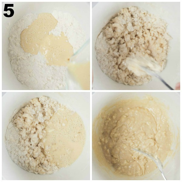Adding whisked wet ingredients to dry ingredients in a white mixing bowl.