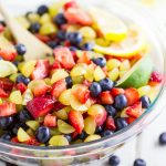 This Best Fruit Salad is easy to make and uses fresh, juicy berries. It's the perfect use for all the fresh summer fruit! Plus, one simple, natural ingredient that makes it amazing. Delicious side or dessert for a summer cookout, potluck, or gathering, and equally as delicious and an ice cream topping!