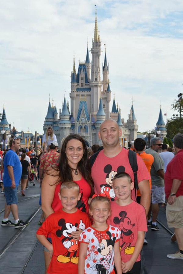 Medlin family with Michelle Medlin, The Gracious Wife, husband, and kids, wearing red shirts at Disney World