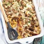 Reuben Casserole is a family favorite with layers of warm egg noodles, tangy sauerkraut, thousand island dressing, corned beef, gooey cheese, and buttery toasted rye bread. It's like a reuben sandwich made even better in one dish for easy clean up! #easyrecipe #stpatricksday