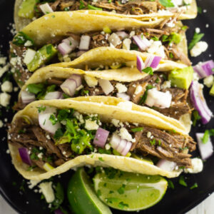 This easy recipe for copycat beef Chipotle Barbacoa is earthy, spicy, and full of Mexican authentic flavor. It is so easy to make, simmered to juicy perfection in the Crock pot or slow cooker.