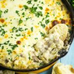 Philly Cheesesteak Dip is a warm, gooey deconstructed version of a sandwich classic. This creamy warm dip recipe is loaded with tender ribeye, fresh green peppers, sweet onions, and melted cheese. Perfect party and game day appetizer.