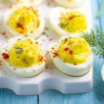 These creamy, tangy Southern Deviled Eggs take a classic staple recipe and add a special ingredient that will make them the best you've ever had! They're super easy to make and dairy free, gluten free, low carb, and keto! My favorite for Easter, potlucks, and parties!