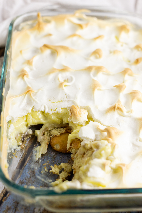 Casserole dish full of southern banana pudding topped with toasted meringue.
